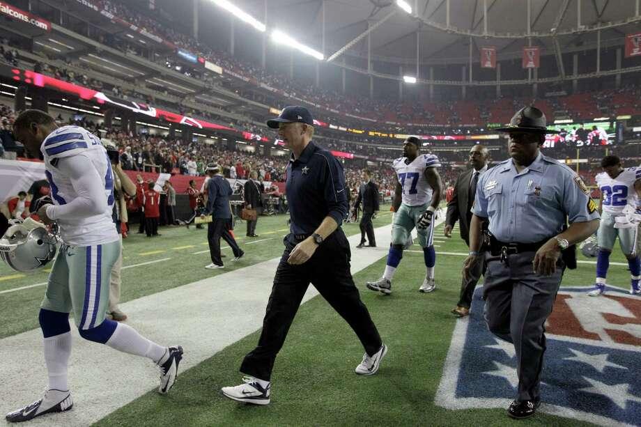 Dallas Cowboys head coach Jason Garrett walks off the field at the end of an NFL football game against the Atlanta Falcons in Atlanta, Sunday, Nov. 4, 2012. Atlanta won 19-13. (AP Photo/Chuck Burton) Photo: Chuck Burton, Associated Press / AP