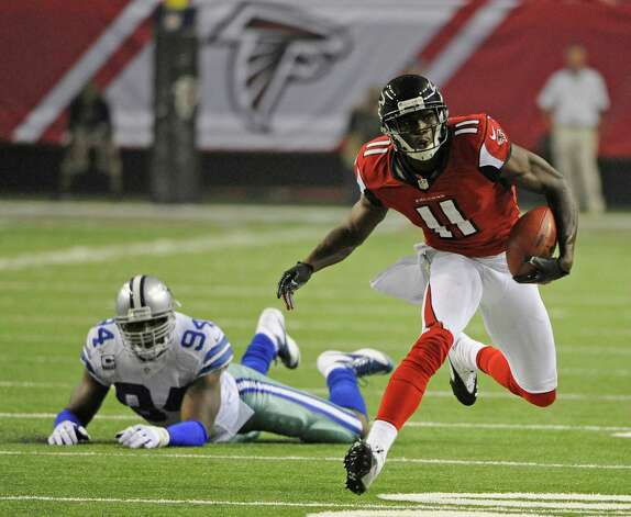 Atlanta Falcons wide receiver Julio Jones (11) breaks into the clear as Dallas Cowboys outside linebacker DeMarcus Ware (94) looks on during the second half of an NFL football game Sunday, Nov. 4, 2012, in Atlanta. (AP Photo/David Tulis) Photo: David Tulis, Associated Press / FR170493 AP