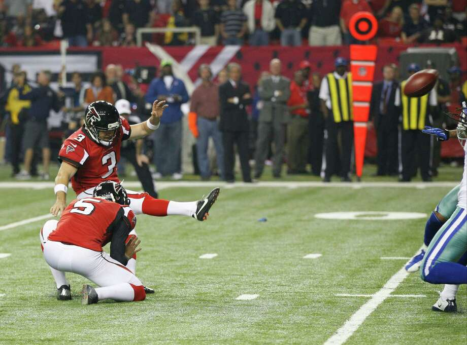 Atlanta Falcons' Matt Bryant (3) kicks a field goal as Matt Bosher (5) holds against the Dallas Cowboys during the second half of an NFL football game in Atlanta, Sunday, Nov. 4, 2012. Atlanta won 19-13. (AP Photo/Chuck Burton) Photo: Chuck Burton, Associated Press / AP