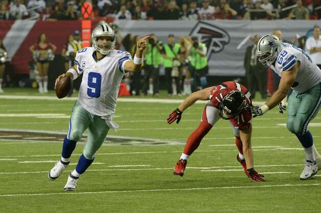 Dallas Cowboys' Tony Romo (9) scrambles against the Atlanta Falcons during the second half of an NFL football game in Atlanta, Sunday, Nov. 4, 2012. Atlanta won 19-13. (AP Photo/Rich Addicks) Photo: Associated Press