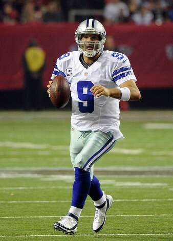 Dallas Cowboys quarterback Tony Romo (9) scrambles during the second half of an NFL football game against the Atlanta Falcons  Sunday, Nov. 4, 2012, in Atlanta. (AP Photo/David Tulis) Photo: David Tulis, Associated Press / FR170493 AP