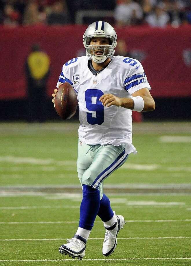 Dallas Cowboys quarterback Tony Romo (9) scrambles during the second half of an NFL football game against the Atlanta Falcons  Sunday, Nov. 4, 2012, in Atlanta. (AP Photo/David Tulis) Photo: David Tulis, Associated Press / FR170493 AP