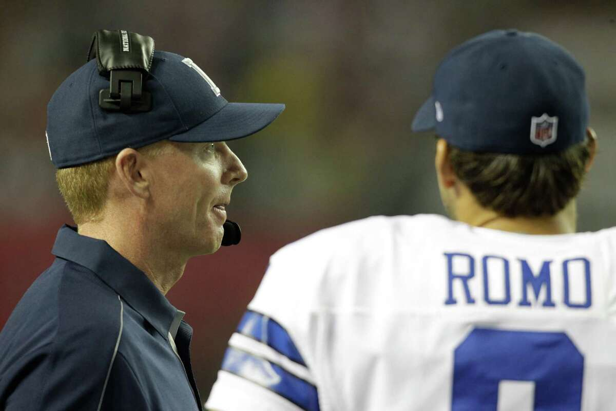 Dallas Cowboys head coach Jason Garrett, left, talks with Tony Romo, right, during the second half of an NFL football game against the Atlanta Falcons in Atlanta, Sunday, Nov. 4, 2012. Atlanta won 19-13. (AP Photo/Chuck Burton)