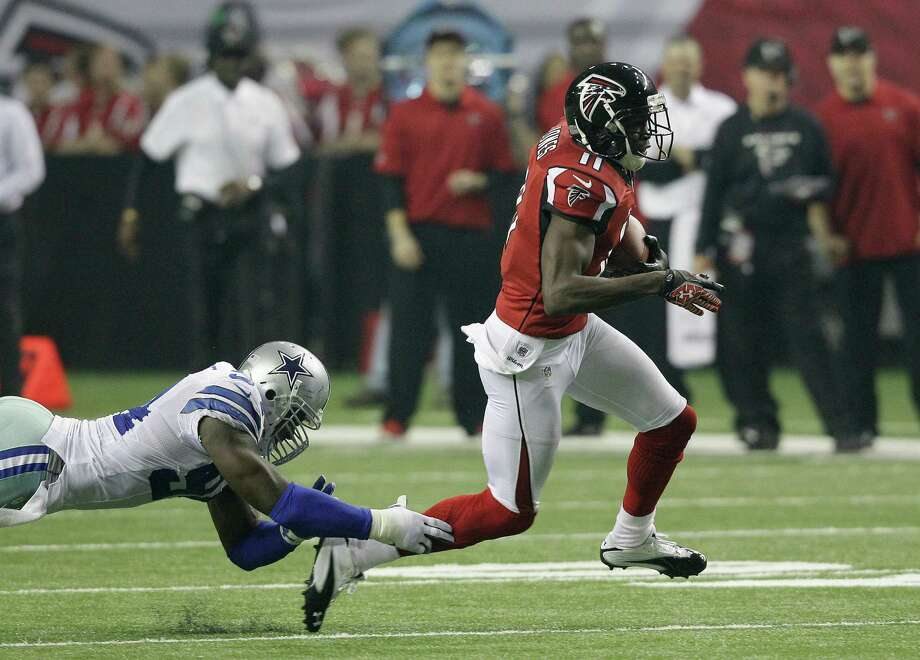 Atlanta Falcons wide receiver Julio Jones (11) runs away from Dallas Cowboys outside linebacker DeMarcus Ware (94)during the second half of an NFL football game Sunday, Nov. 4, 2012, in Atlanta. (AP Photo/Chuck Burton) Photo: Chuck Burton, Associated Press / AP