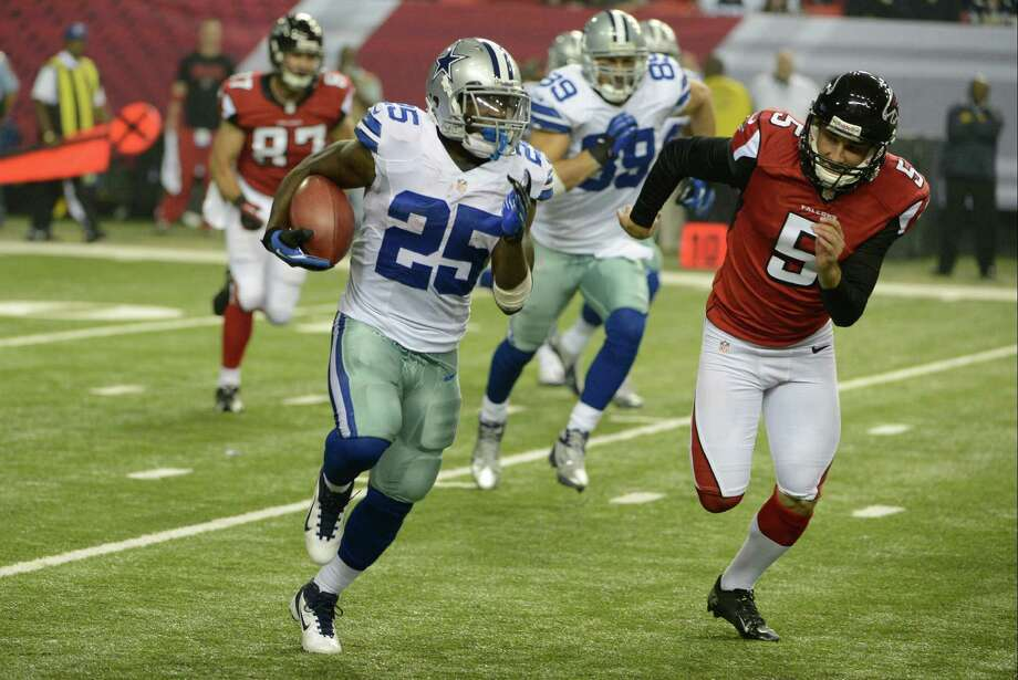 Dallas Cowboys' Lance Dunbar (25) is chased by Atlanta Falcons' Matt Bosher (5) during the second half of an NFL football game in Atlanta, Sunday, Nov. 4, 2012. Atlanta won 19-13. (AP Photo/Rich Addicks) Photo: Associated Press