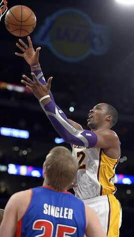 Dwight Howard scored 28 points as the Lakers got their first victory of the season. Photo: Mark J. Terrill, Associated Press