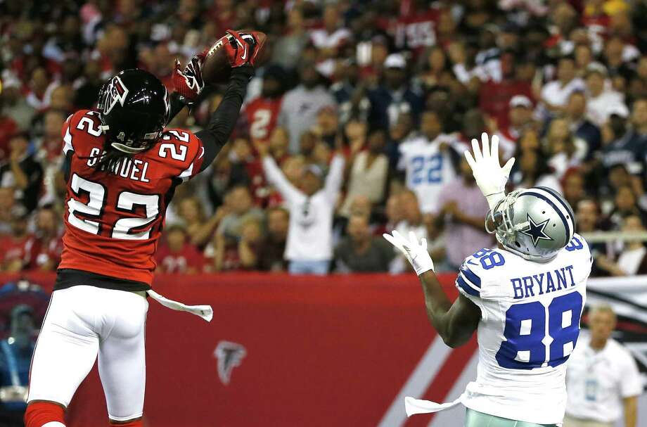 Asante Samuel #22 of the Atlanta Falcons breaks up a touchdown reception intended for Dez Bryant #88 of the Dallas Cowboys at Georgia Dome on November 4, 2012 in Atlanta, Georgia. Photo: Kevin C. Cox, Getty Images / 2012 Getty Images