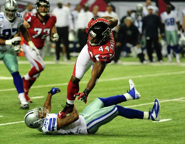Jason Snelling #44 of the Atlanta Falcons is upended by Orlando Scandrick #32 of the Dallas Cowboys at the Georgia Dome on November 4, 2012 in Atlanta, Georgia Photo: Scott Cunningham, Getty Images / 2012 Getty Images