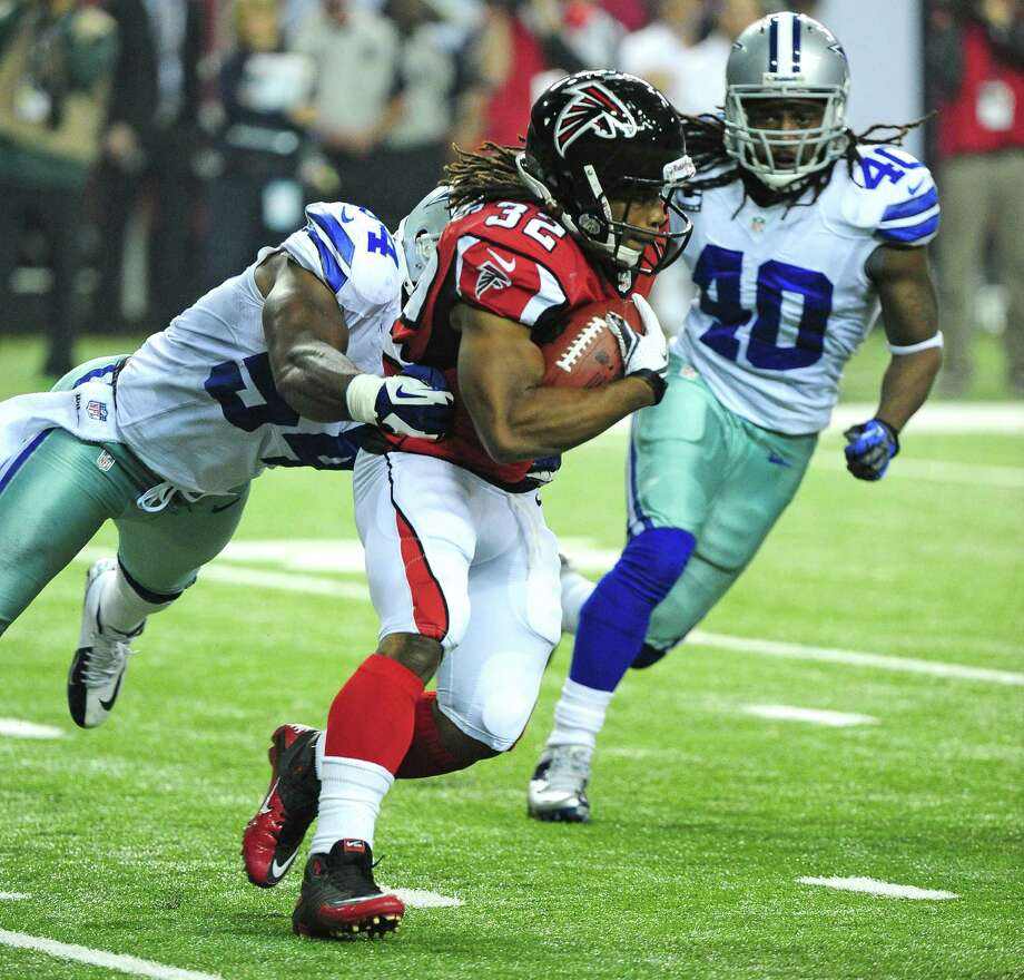 Jacquiz Rodgers #32 of the Atlanta Falcons carries the ball against the Dallas Cowboys at the Georgia Dome on November 4, 2012 in Atlanta, Georgia. The Falcons defeated the Cowboys 19-13. Photo: Scott Cunningham, Getty Images / 2012 Getty Images