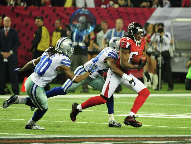 Roddy White #84 of the Atlanta Falcons runs with a catch against Morris Claiborne #24 of the Dallas Cowboys at the Georgia Dome on November 4, 2012 in Atlanta, Georgia. The Falcons defeated the Cowboys 19-13. Photo: Scott Cunningham, Getty Images / 2012 Getty Images