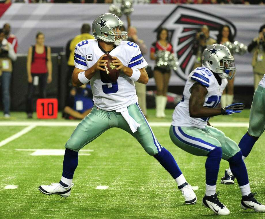 Tony Romo #9 of the Dallas Cowboys passes against the Atlanta Falcons at the Georgia Dome on November 4, 2012 in Atlanta, Georgia. The Falcons defeated the Cowboys 19-13. Photo: Scott Cunningham, Getty Images / 2012 Getty Images