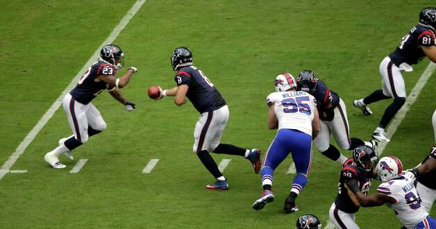 Houston Texans quarterback Matt Schaub (8) hands the ball off to running back Arian Foster (23) in the first quarter of an NFL football game against the Buffalo Bills Sunday, Nov. 4, 2012, in Houston. (AP Photo/David J. Phillip) Photo: David J. Phillip, Associated Press / AP