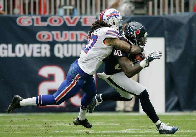 Buffalo Bills' Stephon Gilmore (27) grabs Houston Texans' Andre Johnson (80) in the third quarter of an NFL football game Sunday, Nov. 4, 2012, in Houston. (AP Photo/David J. Phillip) Photo: David J. Phillip, Associated Press / AP
