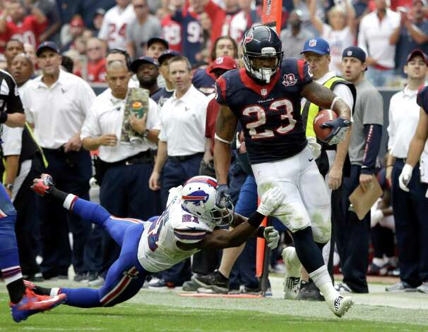Houston Texans running back Arian Foster (23) rushes for gain and Buffalo Bills cornerback Leodis McKelvin (21) pushes him out of bounds in the fourth quarter of an NFL football game Sunday, Nov. 4, 2012, in Houston. (AP Photo/David J. Phillip) Photo: David J. Phillip, Associated Press / AP