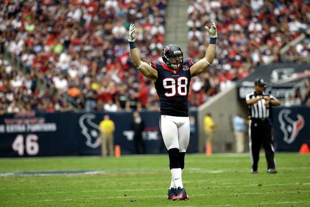 Houston Texans outside linebacker Connor Barwin (98) encourages the crowd in the third quarter of an NFL football game against the Buffalo Bills Sunday, Nov. 4, 2012, in Houston. (AP Photo/David J. Phillip) Photo: David J. Phillip, Associated Press / AP
