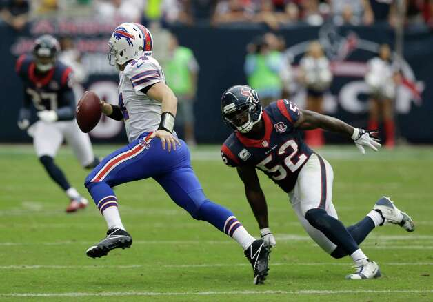 Buffalo Bills' Ryan Fitzpatrick (14) scrambles as Houston Texans' Tim Dobbins (52) defends in the fourth quarter of an NFL football game Sunday, Nov. 4, 2012, in Houston. (AP Photo/Eric Gay) Photo: Eric Gay, Associated Press / AP
