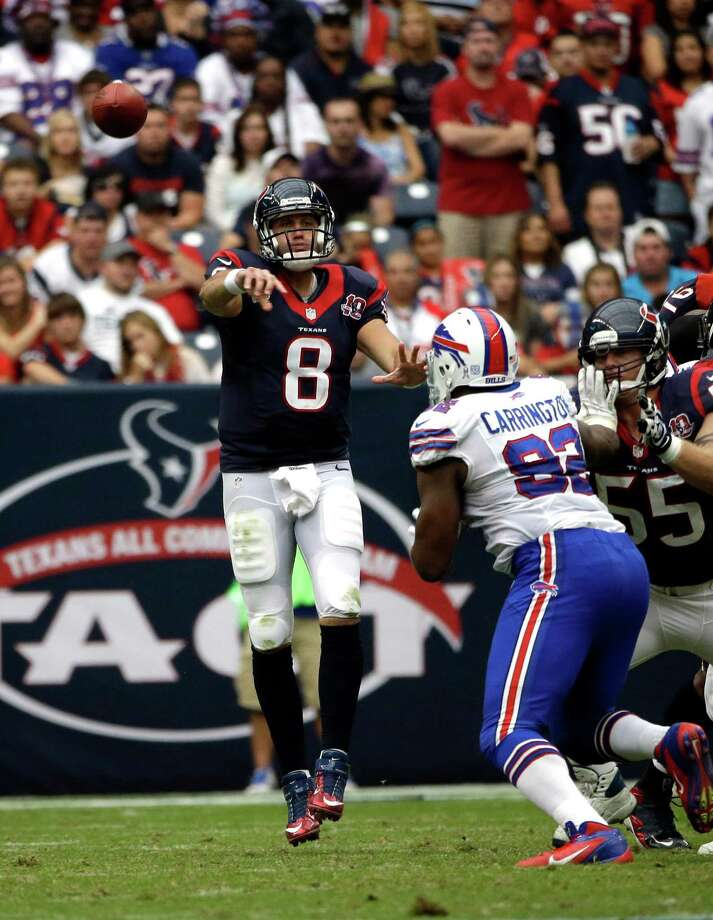 Houston Texans quarterback Matt Schaub (8) throws a pass as Buffalo Bills defensive end Alex Carrington (92) defends in the third quarter of an NFL football game Sunday, Nov. 4, 2012, in Houston. (AP Photo/David J. Phillip) Photo: David J. Phillip, Associated Press / AP