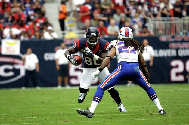 Houston Texans wide receiver Andre Johnson (80) catches a pass as Buffalo Bills cornerback Stephon Gilmore (27) defends in the third quarter of an NFL football game Sunday, Nov. 4, 2012, in Houston. (AP Photo/David J. Phillip) Photo: David J. Phillip, Associated Press / AP