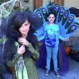 "FINALIST! Excellent work by ""Swamp Girl"" and a peacock. Sarah Jeske describes the costume making kind of like ""Iron Chef."" The girls get an Oct. 1 deadline to decide on a costume, and mom has 30 days to execute. ""It often involves glue guns, sub par sewing skills, rummaging through my husbands tool boxes, cursing, wine and optional weeping."""