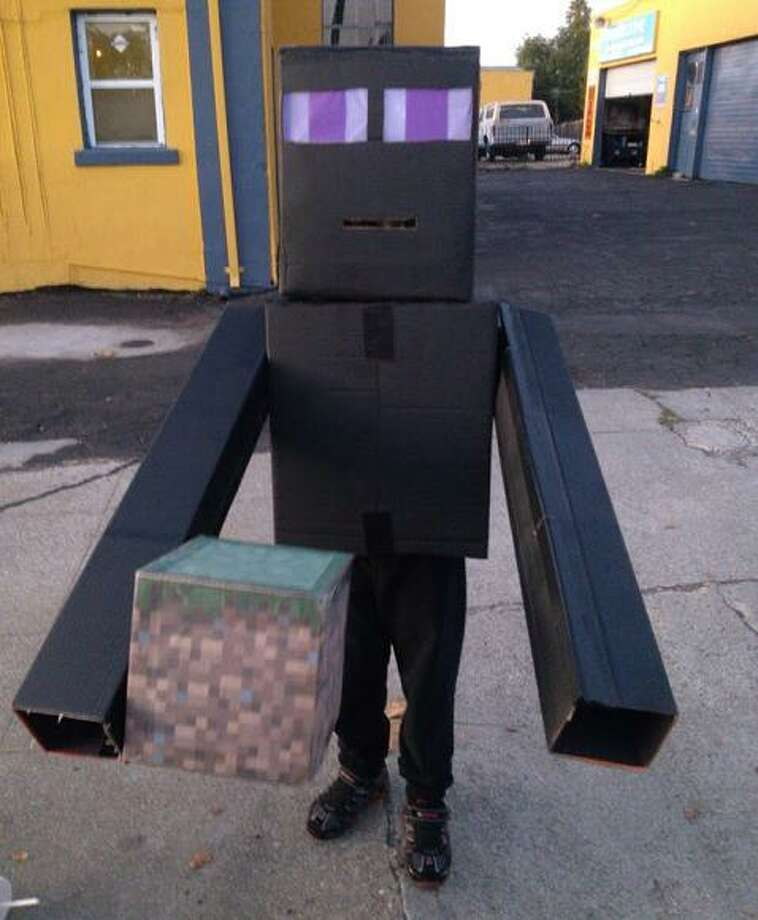 "FINALIST! Stuart appreciated the connection between the virtual building world of Minecraft and this real costume: ""Ironically, that which is easy to do on screen is vexing in real life. Throwing together a few boxes to make an 8-bit character turned out to be an 8 hour job."""