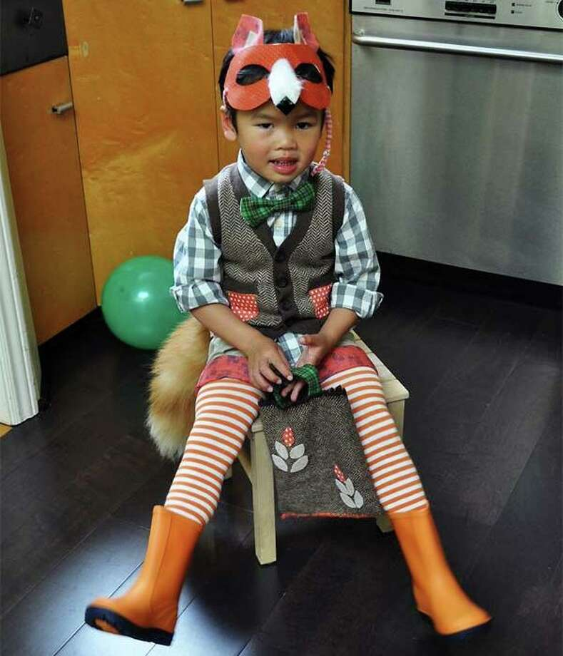 "FINALIST! Cat made this Mr. Fox costume for her son, because ""he is always bright-eyed and bushy tailed and thought this would suit him."""