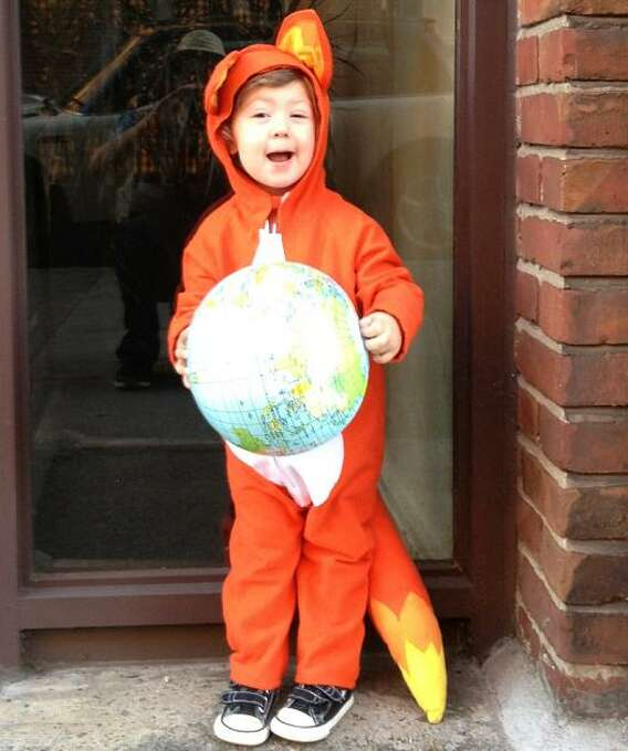 """FINALIST! Tori Paulman's daughter Anika is dressed as the browser Firefox -- part of a theme. Tori writes: """"Mom #1 dressed as Safari, and Mom #2 dressed as Internet Explorer. This costume is entirely HOMEMADE, and my first attempt at sewing a costume ..."""""""