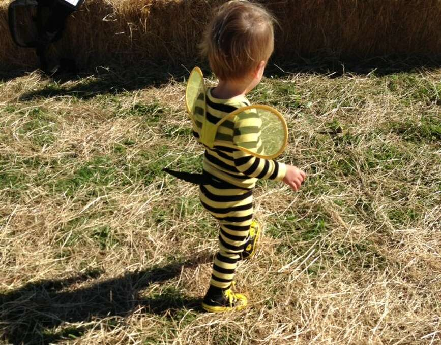 """FINALIST! From Katy M: """"After searching in vain for a decent bee costume without stupid glitter wings and ruffles, I borrowed my son's favorite pajamas paired with Sharpie-colorized Converse and a hand sewn stinger and the Killer Bee was born."""""""