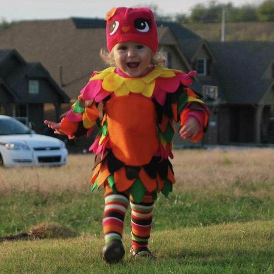 FINALIST! Suzy C. submits this photo of 15-month-old Kaiya. Excellent costume and excellent photography. This is what the Macy's ad would look like, if Macy's sold multicolored owl costumes.