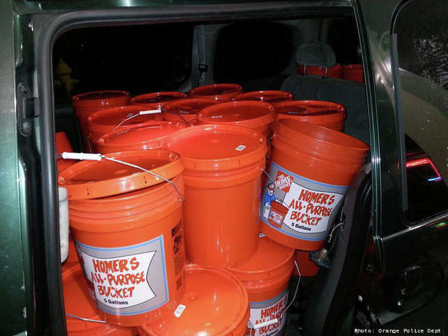 Orange, Conn. police say a Queens, N.Y. man came to Connecticut fo fill unapproved, plastic five-gallon buckets with gas to take back to his neighbors. He, and the gas station attendant where he purchased the gas, were arrested. Photo: Contributed Photo