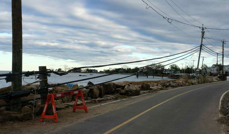 Low-hanging power lines had yet to be repaired along Harbor Road on Sunday in the wake of Hurricane Sandy six days earlier. Photo: Paul Schott / Westport News