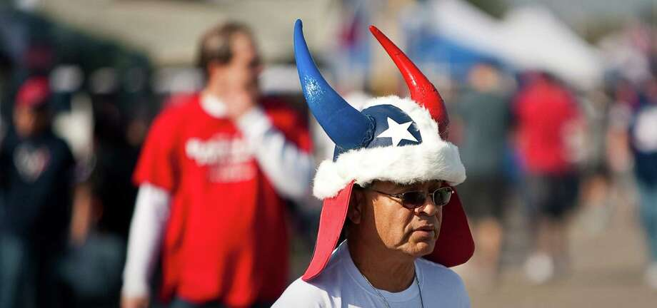 Abel Torres, of League City, shows off a helmet he bought at the Texas Renaissance Festival before the Houston Texans football game against the Buffalo Bills, Sunday, Nov. 4, 2012, outside Reliant Stadium in Houston. Photo: Nick De La Torre, Houston Chronicle / © 2012  Houston Chronicle