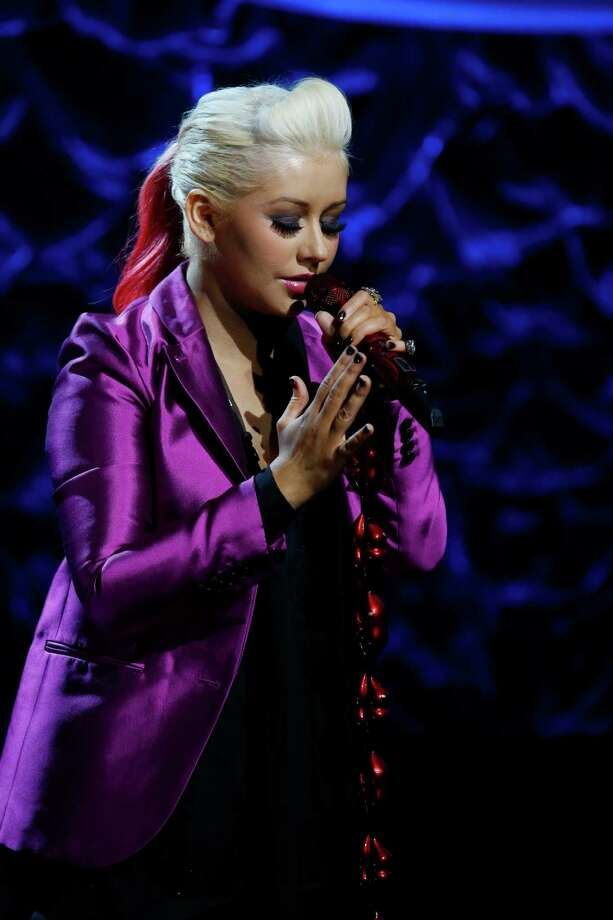 "At the 2011 Super Bowl, Christina Aguilera performed a live rendition of the national anthem featuring a slight change of lyrics. The singer accidentally combined and botched the song when she proudly sung, ""What so proudly we watched, at the twilight's last reaming.""  Photo: Heidi Gutman, AP / NBC"