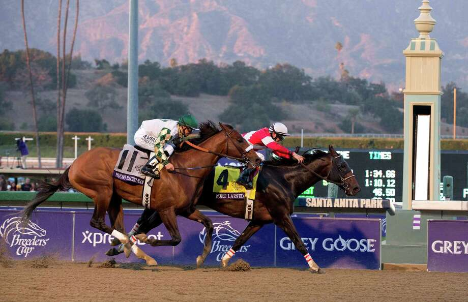 Fort Larned, with Brian Hernandez atop, crosses the finish line ahead of Mucho Macho Man with Mike Smith atop to win the running of the Breeders' Cup Classic horse race, Saturday, Nov. 3, 2012, at Santa Anita Park in Arcadia, Calif. Photo: Julie Jacobosn, AP / AP