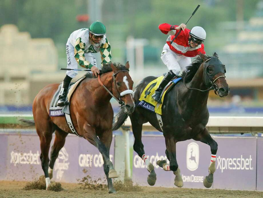 Brian Hernandez atop Fort Larned, reacts as he crosses the finish line ahead of Mucho Macho Man with Mike Smith atop to win the running of the Breeders' Cup Classic horse race, Saturday, Nov. 3, 2012, at Santa Anita Park in Arcadia, Calif. Photo: Jae C. Hong, AP / AP