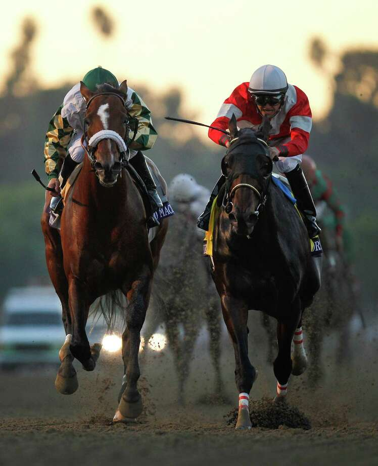 Brian Hernandez atop Fort Larned, right, crosses the finish line ahead of Mucho Macho Man with Mike Smith atop to win the running of the Breeders' Cup Classic horse race, Saturday, Nov. 3, 2012, at Santa Anita Park in Arcadia, Calif. Photo: Mark J. Terril, AP / AP