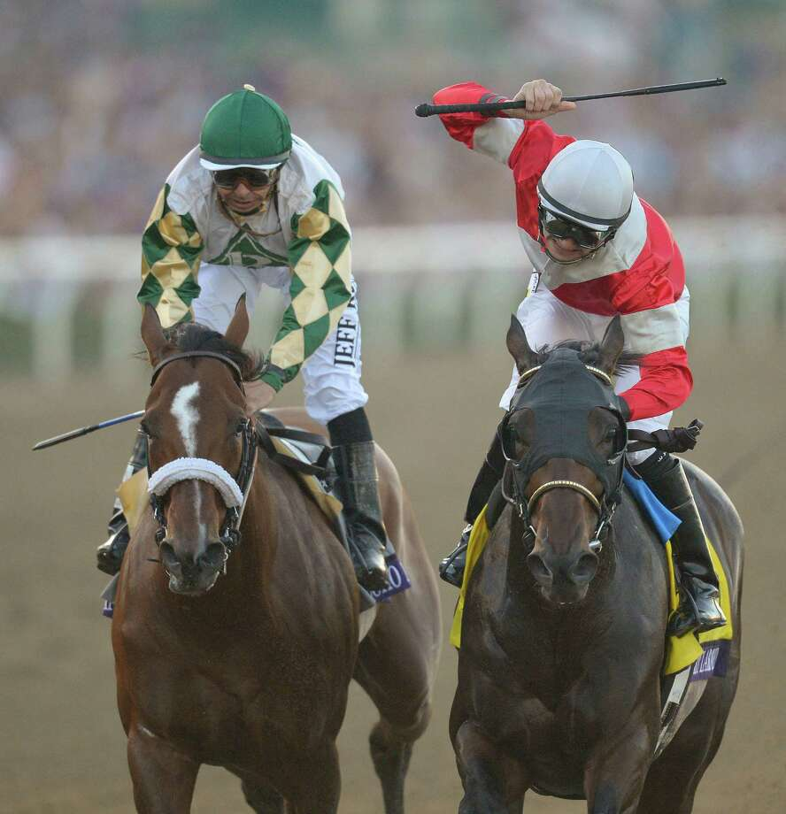 Brian Hernandez Jr., right, reacts atop Fort Larned after finishing ahead of Mucho Macho Man and Mike Smith to win the running of the Breeders' Cup Classic horse race, Saturday, Nov. 3, 2012, at Santa Anita Park in Arcadia, Calif. Photo: Mark J. Terrill, AP / AP