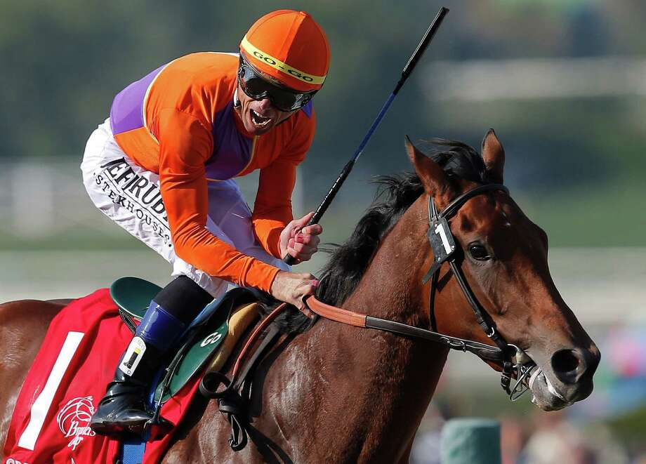 Jockey Garrett Gomez reacts aboard Beholder after crossing the finish line to win the Juvenile Fillies horse race at the Breeders' Cup, Friday, Nov. 2, 2012, Arcadia, Calif. Photo: Jae C. Hong, AP / AP