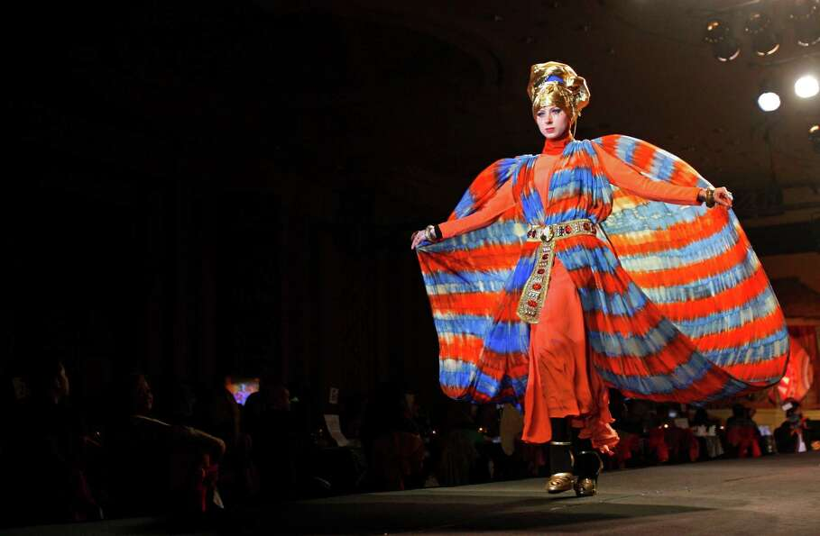 A model presents a creation by designer Dian Pelangi from Indonesia during the Islamic Fashion Festi