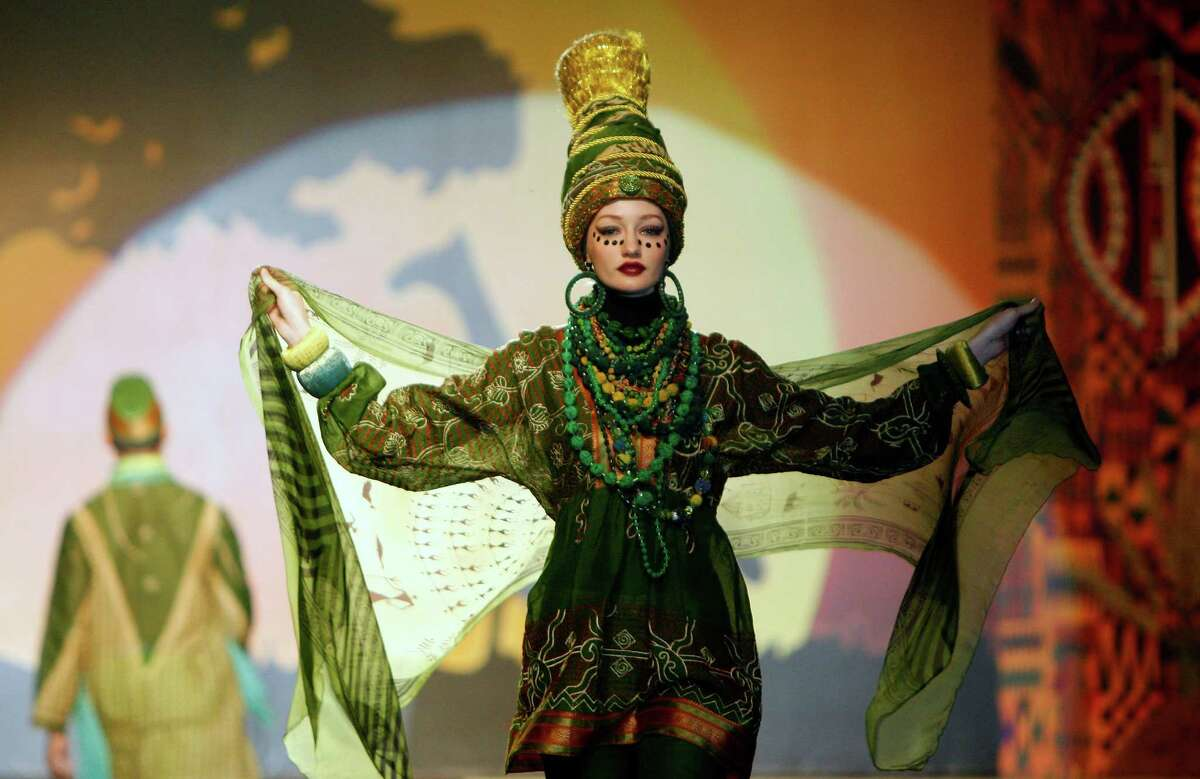 A model presents a creation by designer Paul Robb from Indonesia during the Islamic Fashion Festival in Kuala Lumpur, Malaysia, Monday, Nov. 5, 2012.