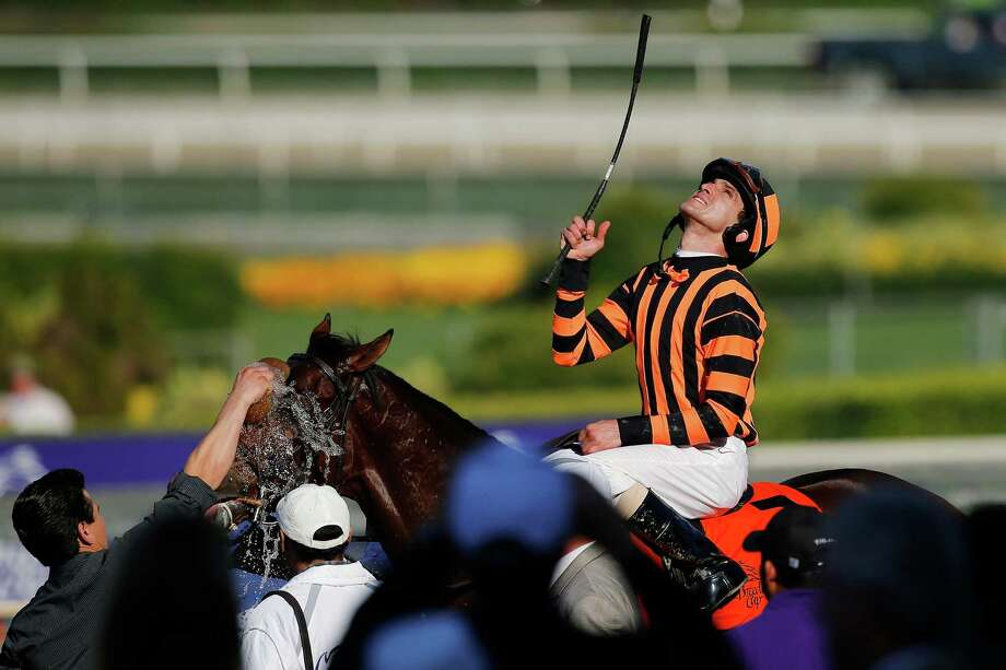 Ramon Dominguez reacts atop Little Mike after winning the Breeders' Cup Turf horse race, Saturday, Nov. 3, 2012, at Santa Anita Park in Arcadia, Calif. Photo: Jae C. Hong, AP / AP