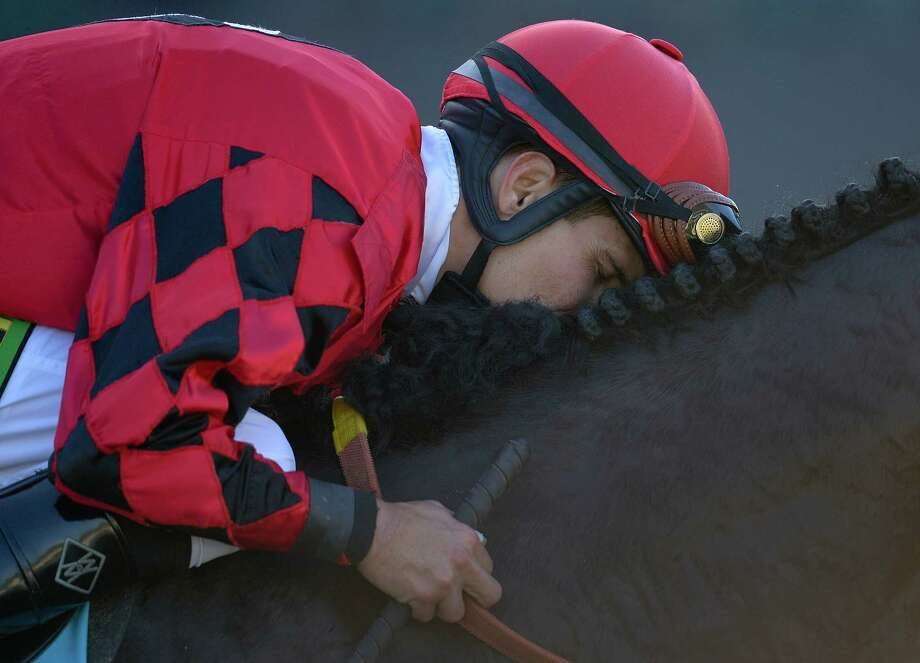 Willie Martinez buries his face into the neck of Trinniberg after winning the running of the Breeders' Cup Sprint horse race, Saturday, Nov. 3, 2012, at Santa Anita Park in Arcadia, Calif. Photo: Mark J. Terrill, AP / AP