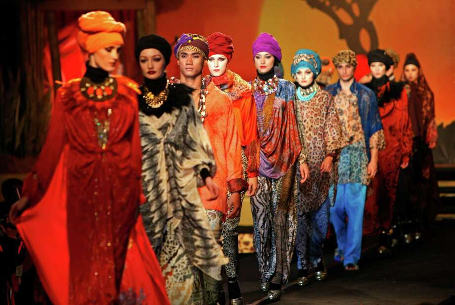 Models present creations by designer Tom Abang Saufi from Malaysia during the Islamic Fashion Festival in Kuala Lumpur, Malaysia, Monday, Nov. 5, 2012. Photo: Lai Seng Sin, AP / AP