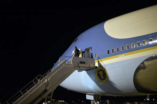 US President Barack Obama disembarks from Air Force One in Madison, Wisconsin, on November 5, 2012. Obama and Republican rival Mitt Romney are both showing signs of exhaustion as they dart from swing state to swing state, trying to fire up enthusiasm among supporters and win over any last wavering voters before November 6 election.  AFP PHOTO / Jewel Samad Photo: JEWEL SAMAD, AFP/Getty Images / 2012 AFP