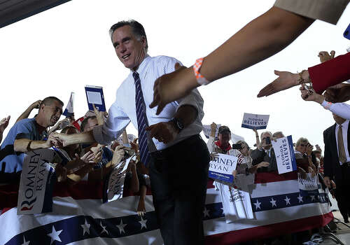 SANFORD, FL - NOVEMBER 05:  Republican presidential candidate, former Massachusetts Gov. Mitt Romney greets supporters during a campaign rally at Avion Jet Center on November 5, 2012 in Sanford, Florida. With one day to go until election day, Romney is making one final push throughout swing states. Photo: Justin Sullivan, Getty Images / 2012 Getty Images