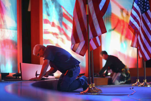 BOSTON, MA - NOVEMBER 05:  Workers set up the stage at the Boston Convention and Exhibition Center for the Mitt Romney Campaign's election night event November 5, 2012 in Boston, Massachusetts. National polls show that Romney and U.S. President Barack Obama are in a virtual dead heat in the race for the presidential election on Tuesday. Photo: Joe Raedle, Getty Images / 2012 Getty Images