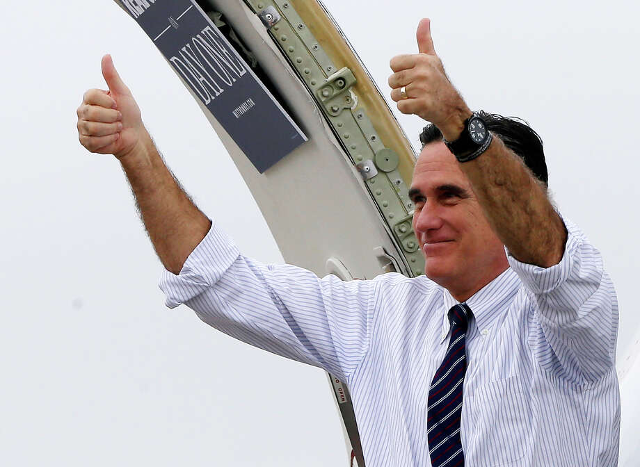 Republican presidential candidate, former Massachusetts Gov. Mitt Romney gives two thumbs up as he boards his campaign plane after a Florida campaign rally at Orlando Sanford International Airport, in Sanford, Fla., Monday, Nov. 5, 2012, enroute to Virginia. Photo: AP