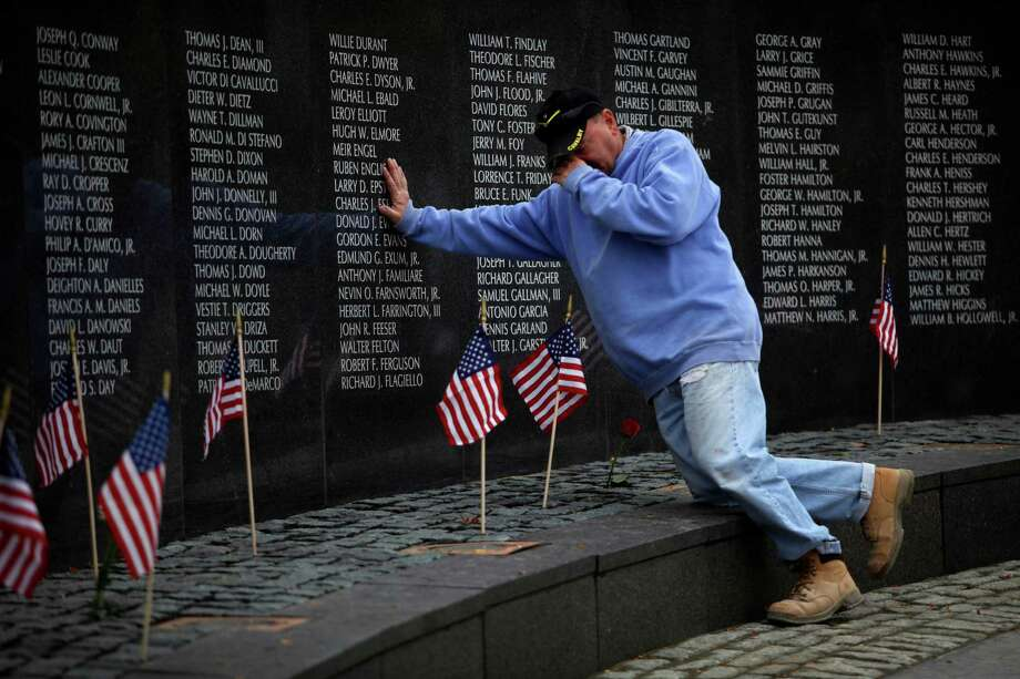 Veteran Mario Morrone visits a memorial near Philadelphia and pays his respects to friends who died while serving in Vietnam. Wednesday, Vietnam veterans will be welcomed home at Fort Sam Houston. Photo: File Photo, Associated Press / AP