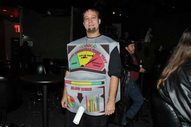 Adam Geckler is dressed as a breathalyzer at Fitzgerald's.