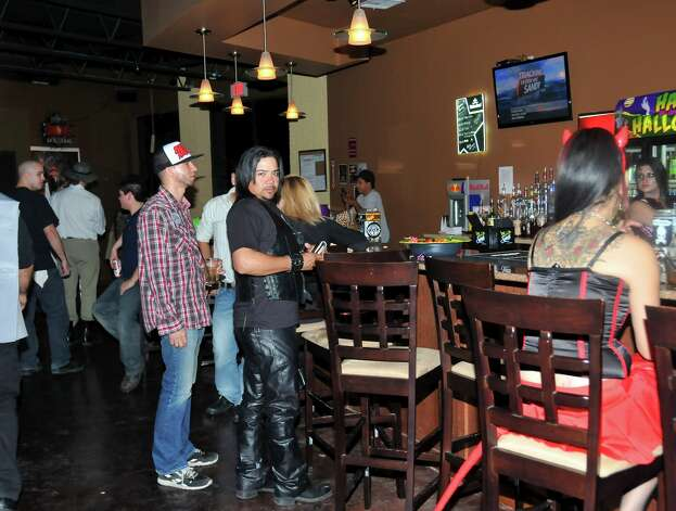 Eddie Gabryelski and Andy Garza are grabbing a drink at the bar in Fitzgerald's.