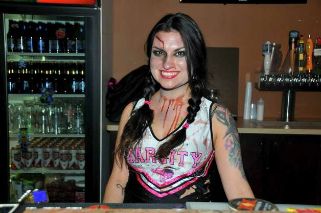 Summer Ortega is having a fun night bartending in a gory costume at Fitzgerald's.
